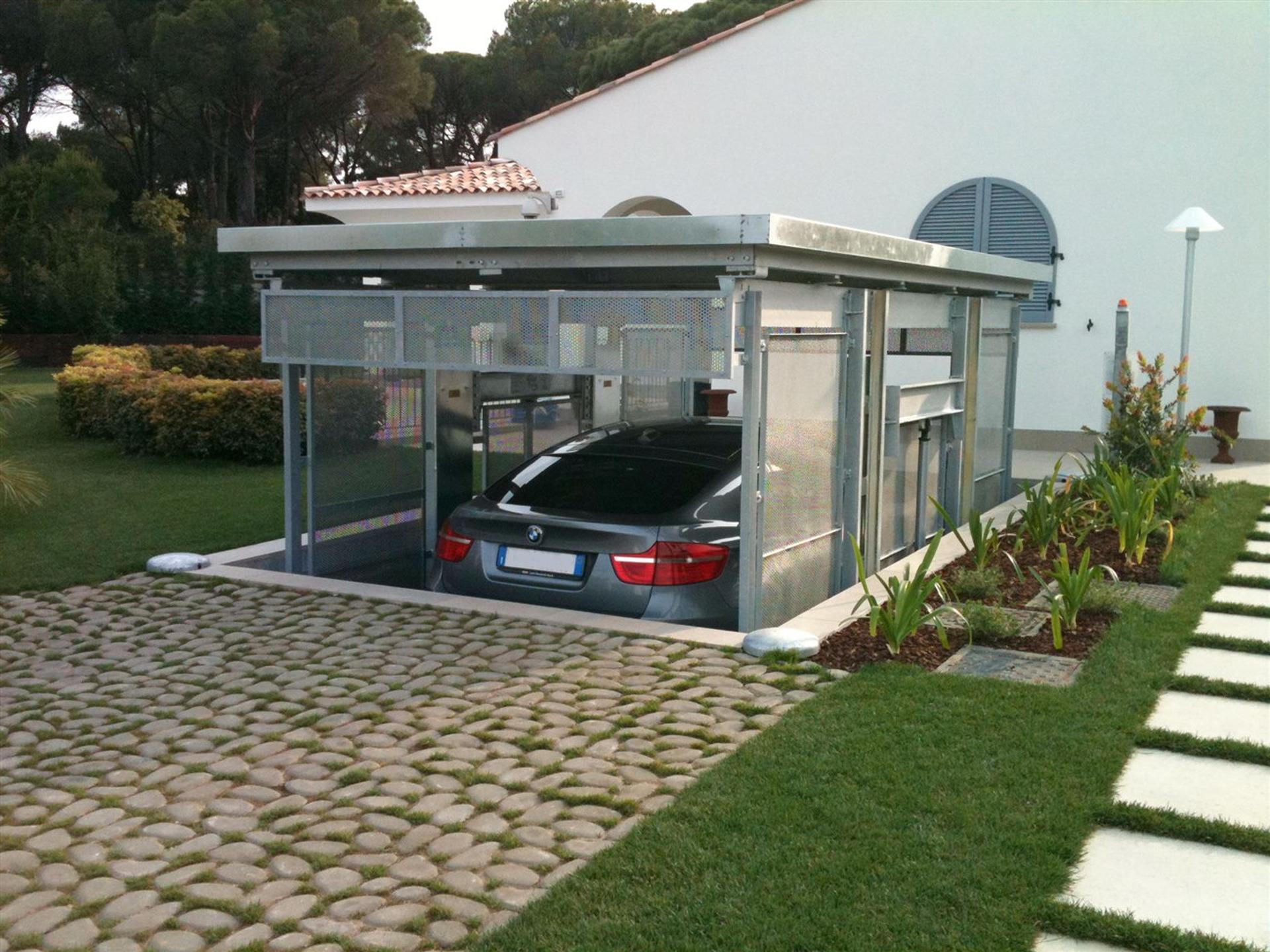 Ip1 cm fb42 montauto con tetto di copertura for Garage per 2 auto